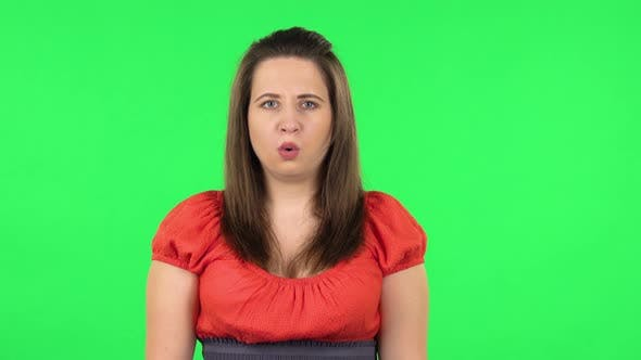 Thumbnail for Portrait of Frustrated Girl Says Wow with Shocked Facial Expression. Green Screen