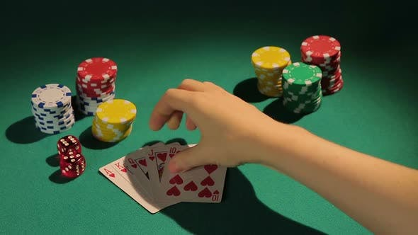 Thumbnail for Lucky Gambler Showing Down Royal Flush Hand, Poker Player Wins Bank in Casino