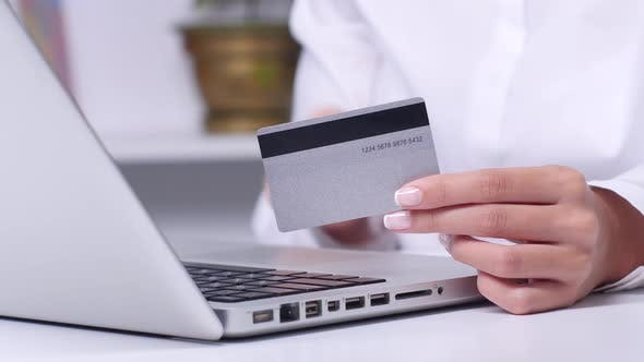 Thumbnail for Woman Buying Online with a Silver Credit Card and Tablet. Close Up