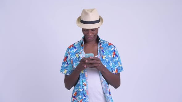 Thumbnail for Young Happy African Tourist Man Smiling While Using Phone
