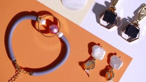Elegant Jewelry on Color Background