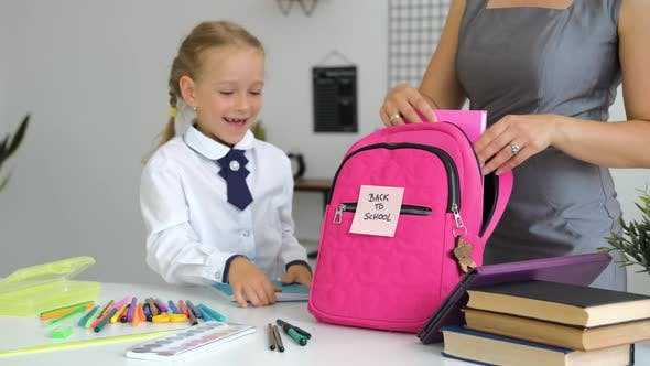 Pupil Girl with Mother Preparing for School