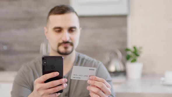 Thumbnail for Man Doing Online Shopping with Smartphone