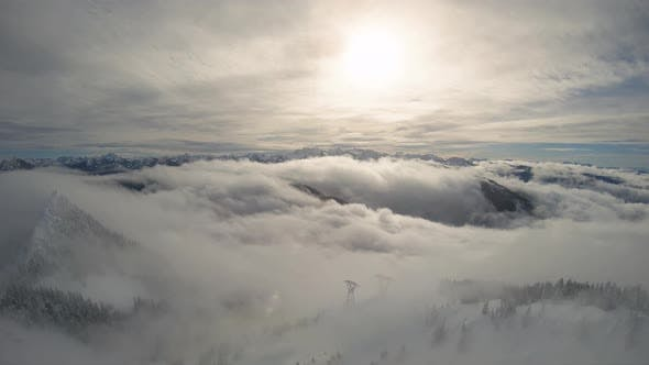 Thumbnail for Pacific Northwest Snow Covered Mountain Wilderness Aerial With Rolling Clouds