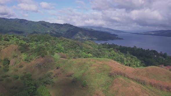 Arenal Lake and rainforest near La Fortuna, Costa Rica. Aerial drone view