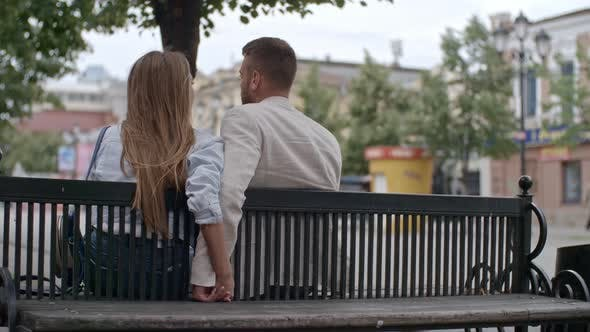 Cover Image for Couple Sitting on Bench and Holding Hands
