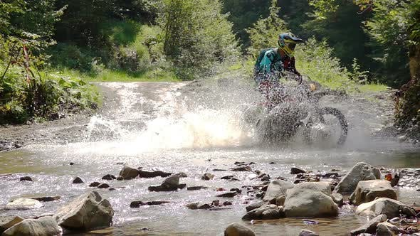Cover Image for Motocycle Rider Crosses Mountain River