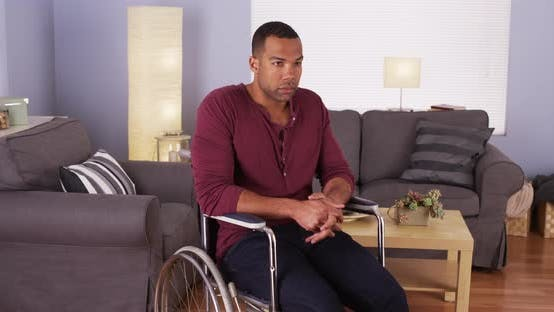 Thumbnail for Disabled African man sitting in wheelchair at home