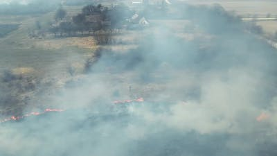 Aerial Flight Over the Fire in the Field