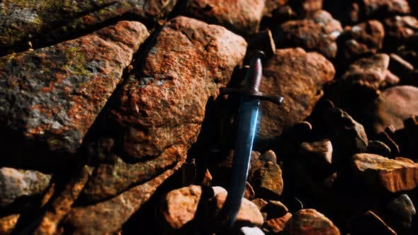 Old Dagger on the Rock at Sunset