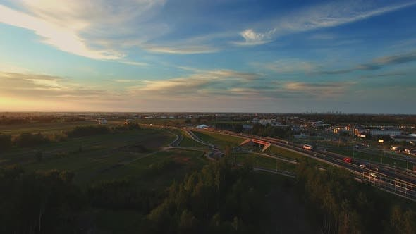 Thumbnail for Complex Road Junction. Sunny Day, Sunset. Modern Europe. Aerial High Altitude Drone Flight.