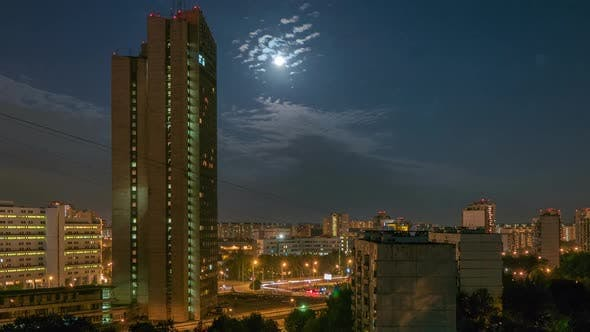 Cover Image for Night City With Moon and Clouds Motion