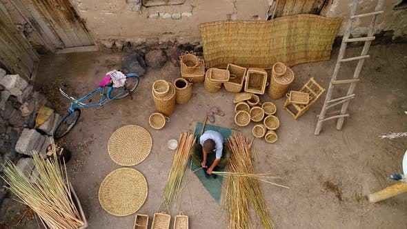Thumbnail for Aerial View Hands People Weaving Basket