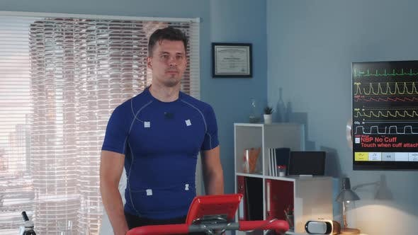 Multiracial Doctor Increasing Speed on the Treadmill During the Athlete Stress Test