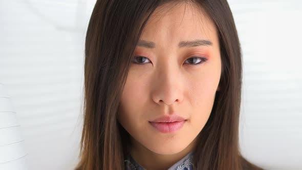 Thumbnail for Chinese woman looking at camera