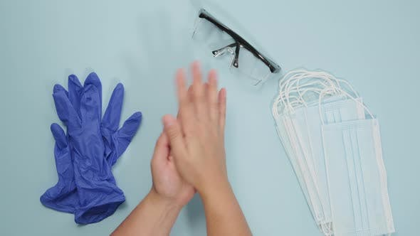 woman disinfects her hands with antiseptic foam