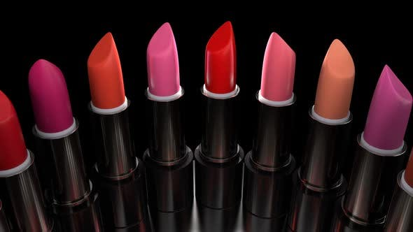 Lipsticks with the Red Palette Rotates on the Showcase in the Perfume Store