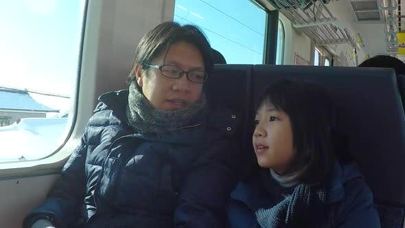 Asian Father And Daughter Travel By Train