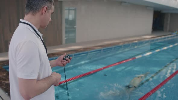 Man Coaching Professional Swimmer