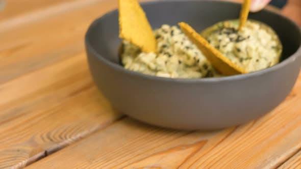 Thumbnail for Waitress Moves Tasty Raw Food Dessert in Black Bow Closeupl