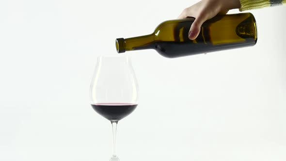 Thumbnail for Rich Red Wine Being Poured Into Balloon Wineglass, White, Slowmotion