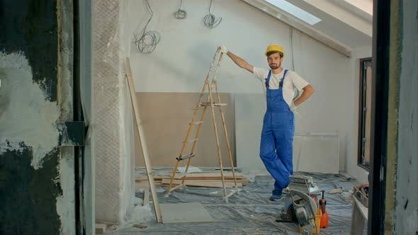 Thumbnail for Young Handyman or Builder Standing in House Looking at the Camera
