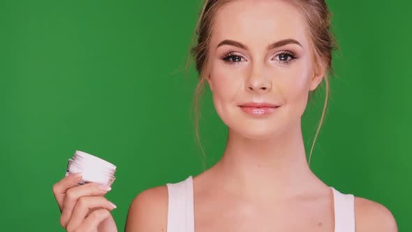Thumbnail for Beautiful Young Woman with Cream in Her Hand