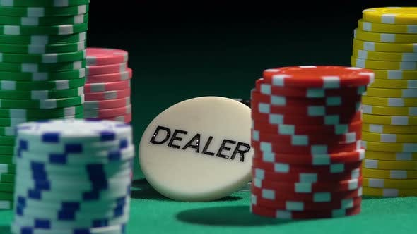 Thumbnail for A large number of chips lying on green gambling table, throwing dice in slow-mo