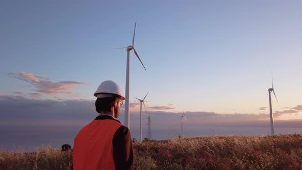 Thumbnail for Engineer Walks Towards Wind Turbines