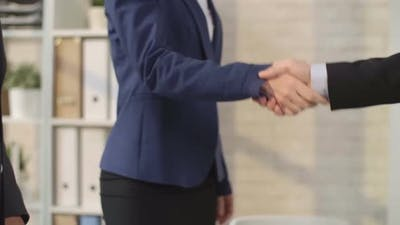 Female Boss Entering a Meeting