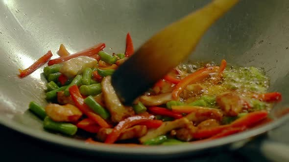 Cook Prepares in a Frying Pan, in Oil, with Fresh Vegetables - Potatoes, Tomatoes, Green Beans