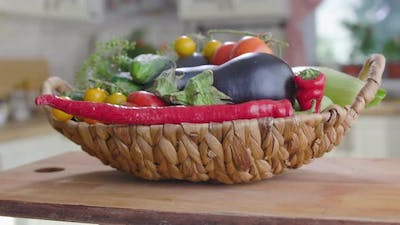 Basket Of Vegetables Is On the Table In Kitchen