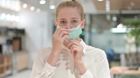 Portrait of Young Businesswoman Wearing Protective Face Mask