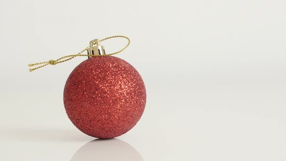 Thumbnail for Christmas ornament on white background  4K 2160p 30fps UltraHD tilting  footage - Red shiny bauble w