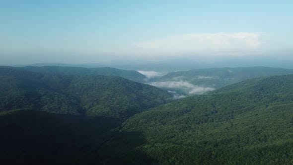 Thumbnail for Aerial Landscape View of Caucasus Mountain at Sunny Morning with Fog.