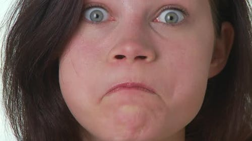 Portrait of young woman making silly faces