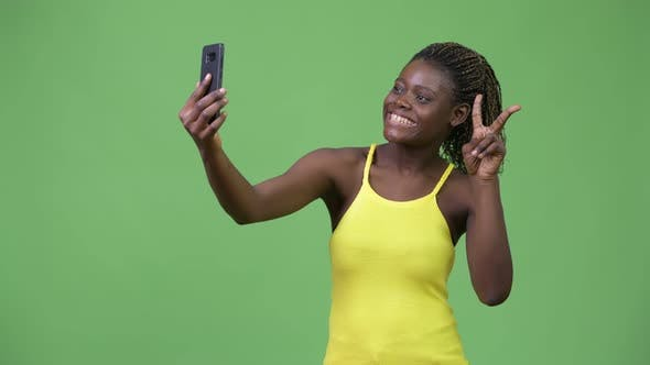 Thumbnail for Young African Woman Taking Selfie