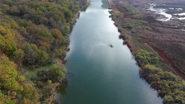 Drone flies over the river