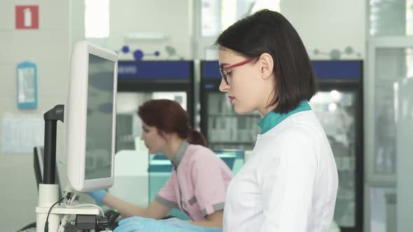 Thumbnail for Beautiful Female Scientist Working on a Computer at the Lab