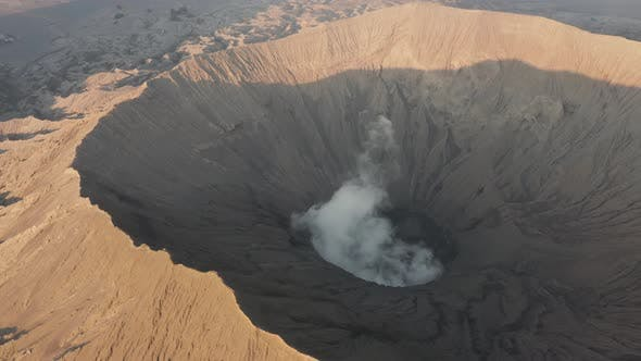 Thumbnail for Aerial view of steam venting from an active volcano