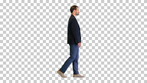 Fashionable businessman in a suit walking slowly, Alpha Channel