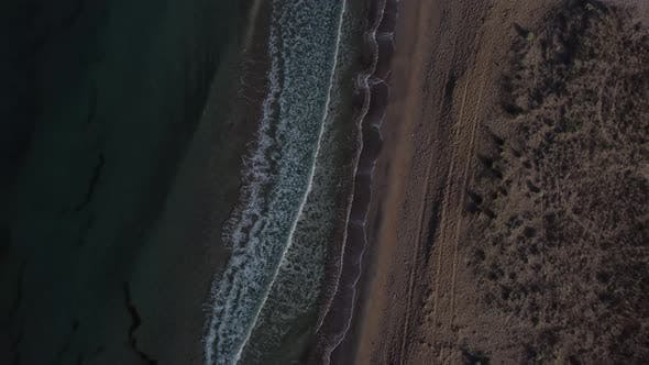 Beautiful Coastline with Waves Shooting From a Bird'seye View By Drone