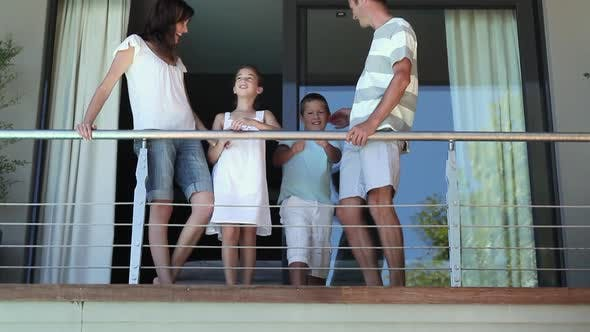 Thumbnail for Family on balcony of holiday home