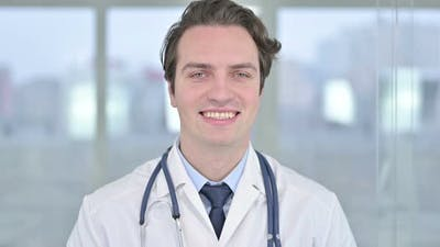 Portrait of Smiling Young Doctor Looking at the Camera