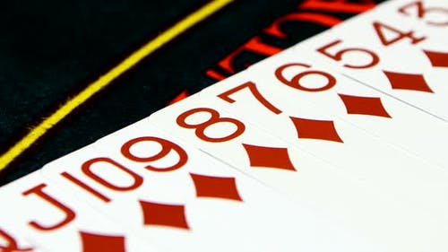 Deck of Cards Laid Out on Casino Table, Close Up