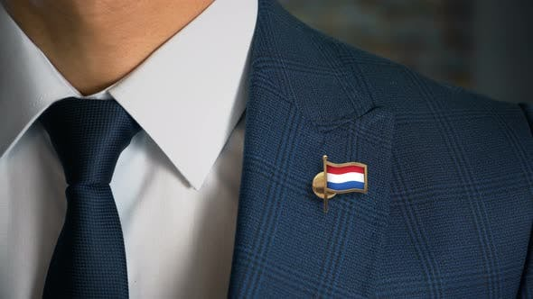 Thumbnail for Businessman Walking Towards Camera With Country Flag Pin Netherlands