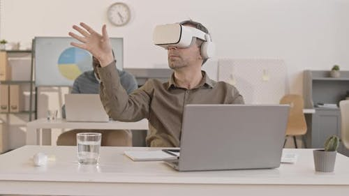 Man Using VR Headset in Office