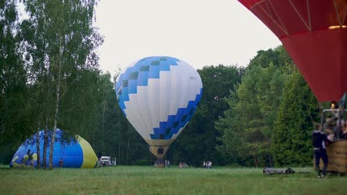 Hot Air Balloon with Passengers Taking Off the Ground, Recreational Activity