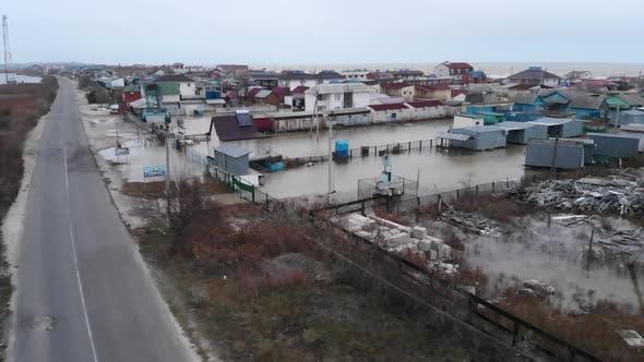 Flood in a Settlement Near the Sea