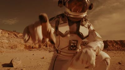 Male Astronaut Recording Video on Mars